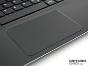 The very large mouse pad can be pressed on its surface for a click (like Apple's).