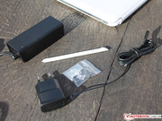 The accessories are comprised of two power supplies (smaller one for the keyboard) and a stylus inserted in the tablet.
