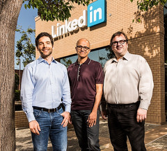 Microsoft acquires LinkedIn, company's founders next to Microsoft CEO Satya Nadella