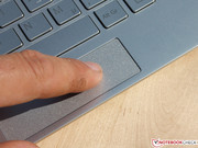 The button is hidden beneath the clickpad area. Depending on the position of the user's finger, right and left mouse clicks are recognized, too.