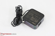 Small AC adapter (7.5 x 7.5 x 3.0 cm) outputs 19 Volts