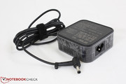 Small (7.5 x 7.5 x 3.0 cm) AC adapter outputs 19 V