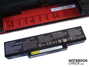 The battery is pushed into the case's rear