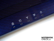 Numerous status LEDs are found below the touchpad.