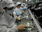 Workers at a Foxconn factory in Shenzhen, China. (Source: AFP/AFP/Getty Images)