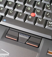 A true Thinkpad also has a red trackpoint between its black keys as an additional mouse replacement beside the touchpad.