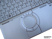 ... a round touchpad with...