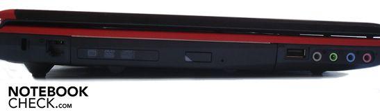 Left side: Kensington Lock, RJ-11 modem jack, DVD-writer, 1x USB 2.0, 4x sound (line-out, headphone jack, line-in, microphone jack)