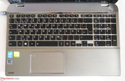 The keyboard layout and the small space bar take some time getting used to, ...