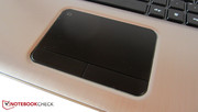 The touchpad surface is lightly rubberized.