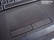 A delicate honeycomb pattern adorns the well-dimensioned touchpad.