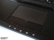 Various status lights are located below the touchpad.