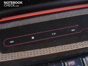 The touchscreen bar features a multimedia control...