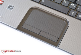 The surface of the touchpad is textured.