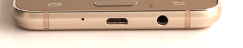 Lower edge: USB port, 3.5 mm headset jack