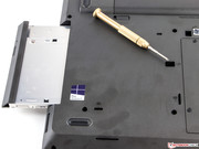 You can replace the optical drive without opening the case.
