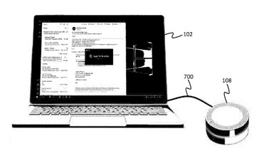 The dock can be wired to the PC to take voice input and VoIP calls. (Source: USPTO)