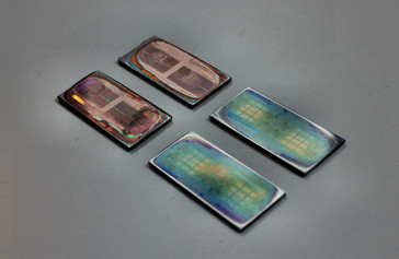 The four Threadripper dies sanded to different layers. (Source: de8auer)