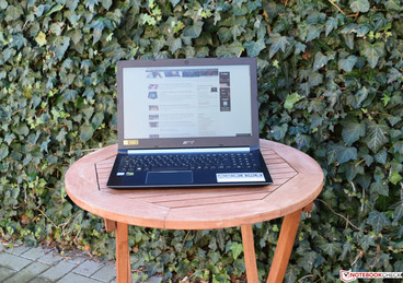 The Acer Aspire 7 A715 in the shade