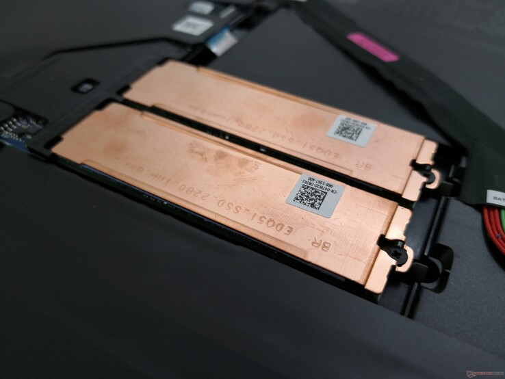 Copper plates to aid in SSD heat dissipation. Most other laptops do not offer any cooling at all for NVMe SSDs