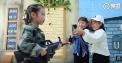 "The video for ""Huawei Beauty"" has everything from a child soldier to bizarre alcohol-related signage. (Source: YouTube/Hong Kong Free Press)"