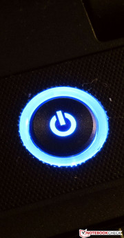 The blue light of the power button provides a colorful accent.