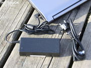 The heavy 90 watt power adapter (360 grams) supplies the laptop's