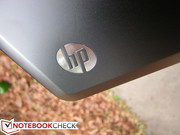 The outer HP logo glows white when the notebook is powered on
