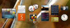 The mini-applications from left to right: Media Center, calendar, system utilisation, puzzle, slideshow, stocks, news feeds, currency calculator, weather, clock