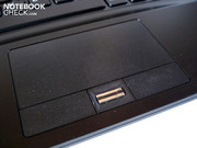 A fingerprint scanner sits between the touchpad keys.